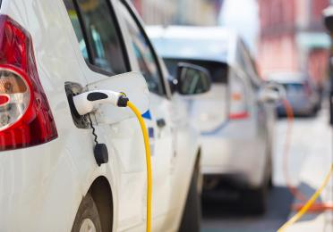 Electric vehicles charging on the street